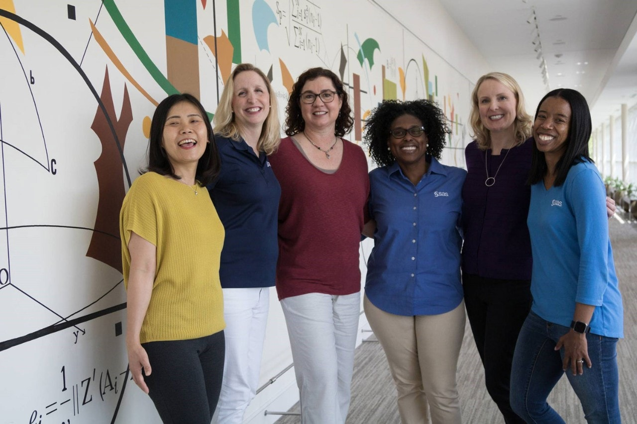Women SAS employees happily gather to celebrate workplace culture award.