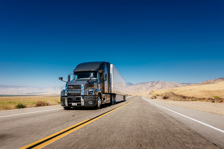 Mack truck driving through desert