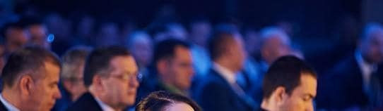 People listening at a conference