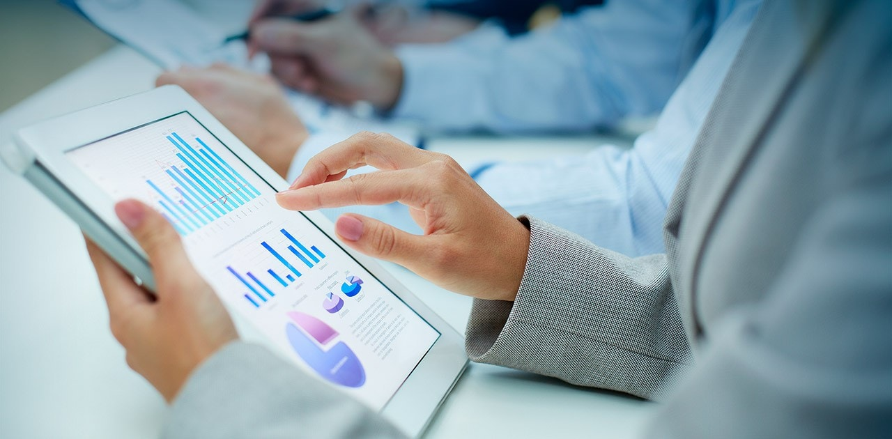 business woman viewing report on tablet device