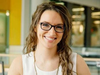 Young woman wearing glasses and smiling
