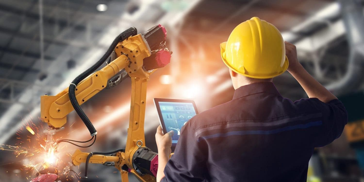 Man in manufacturing setting using tablet device