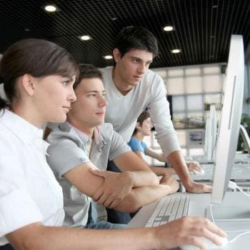 Group of students working together on computer