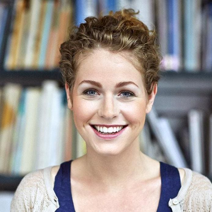 Female student smiling in library