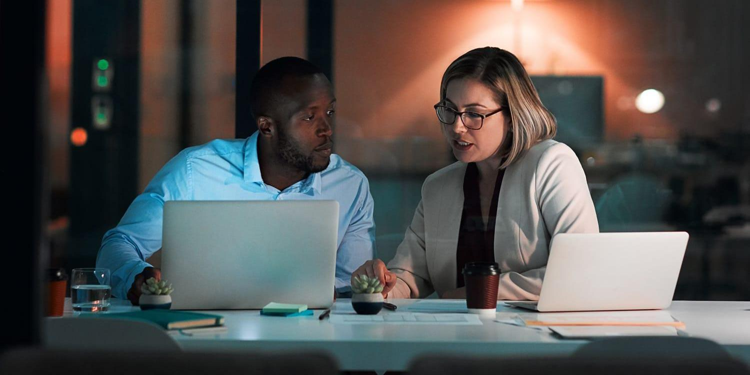 Man and woman working late in office