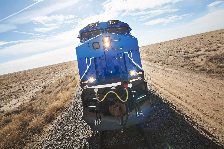 Train on tracks through field