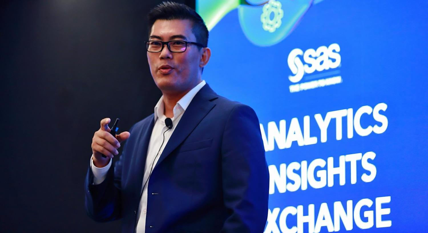 SAS male employee presenting on stage