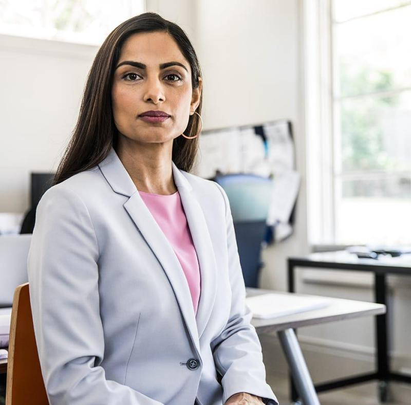 Woman in open business office