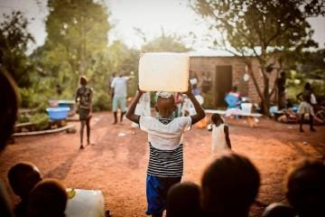 Child Carrying Water on Head