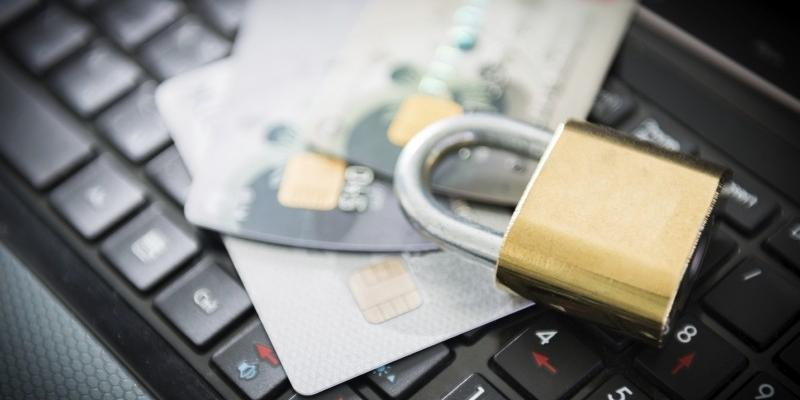 Padlock and credit cards sitting on keyboard