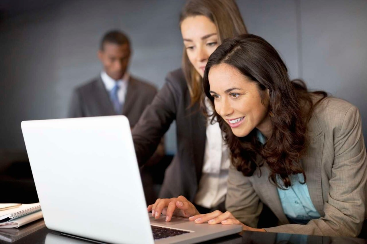 Business Women Looking at Laptop