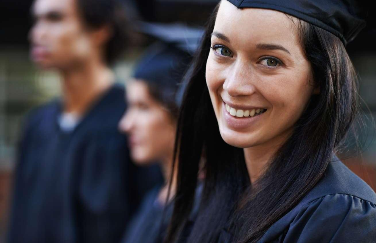 Young College Graduate Smiling At Camera