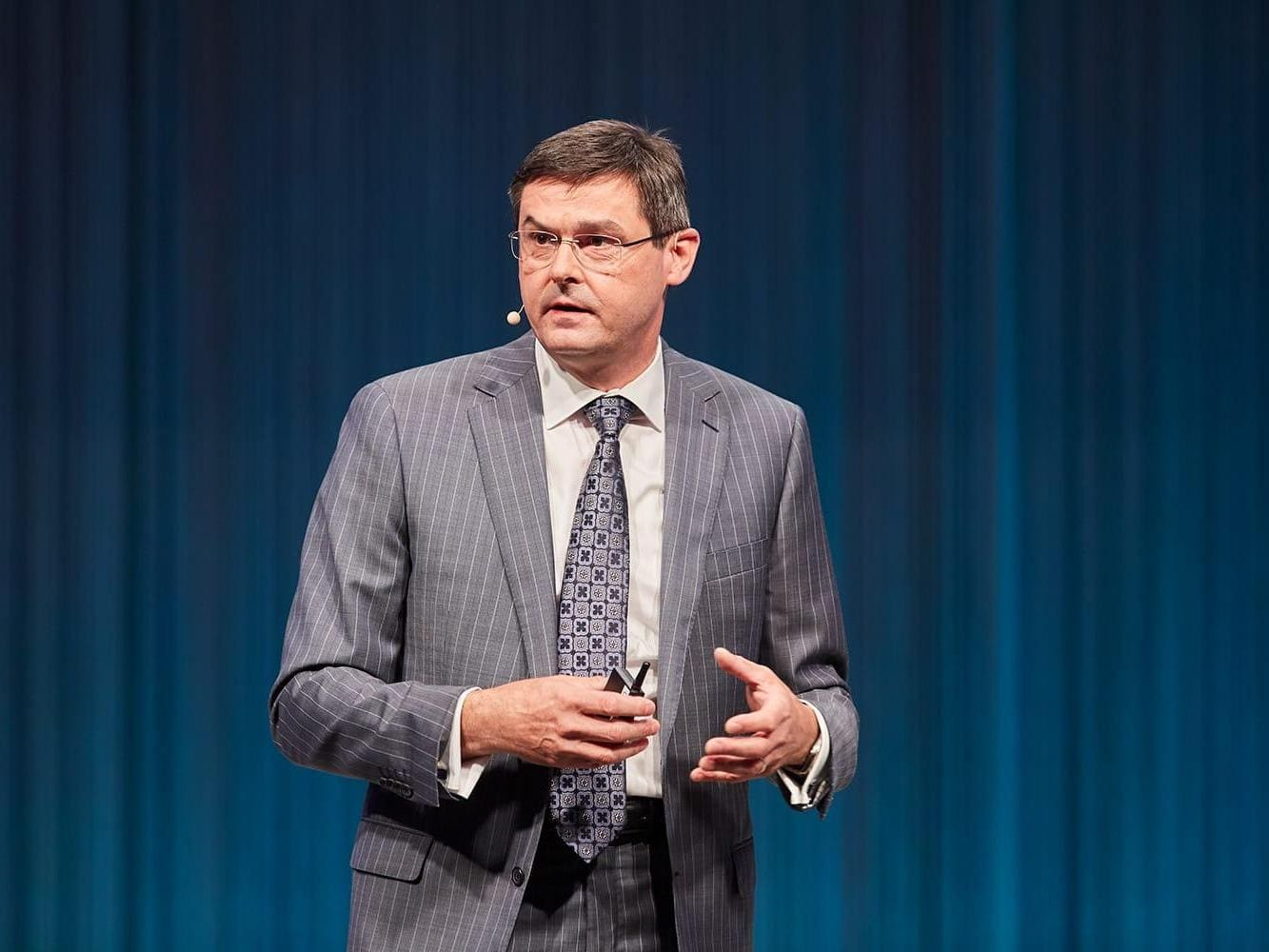Oliver Schabenberger, COO and CTO of SAS, presenting on stage at an event