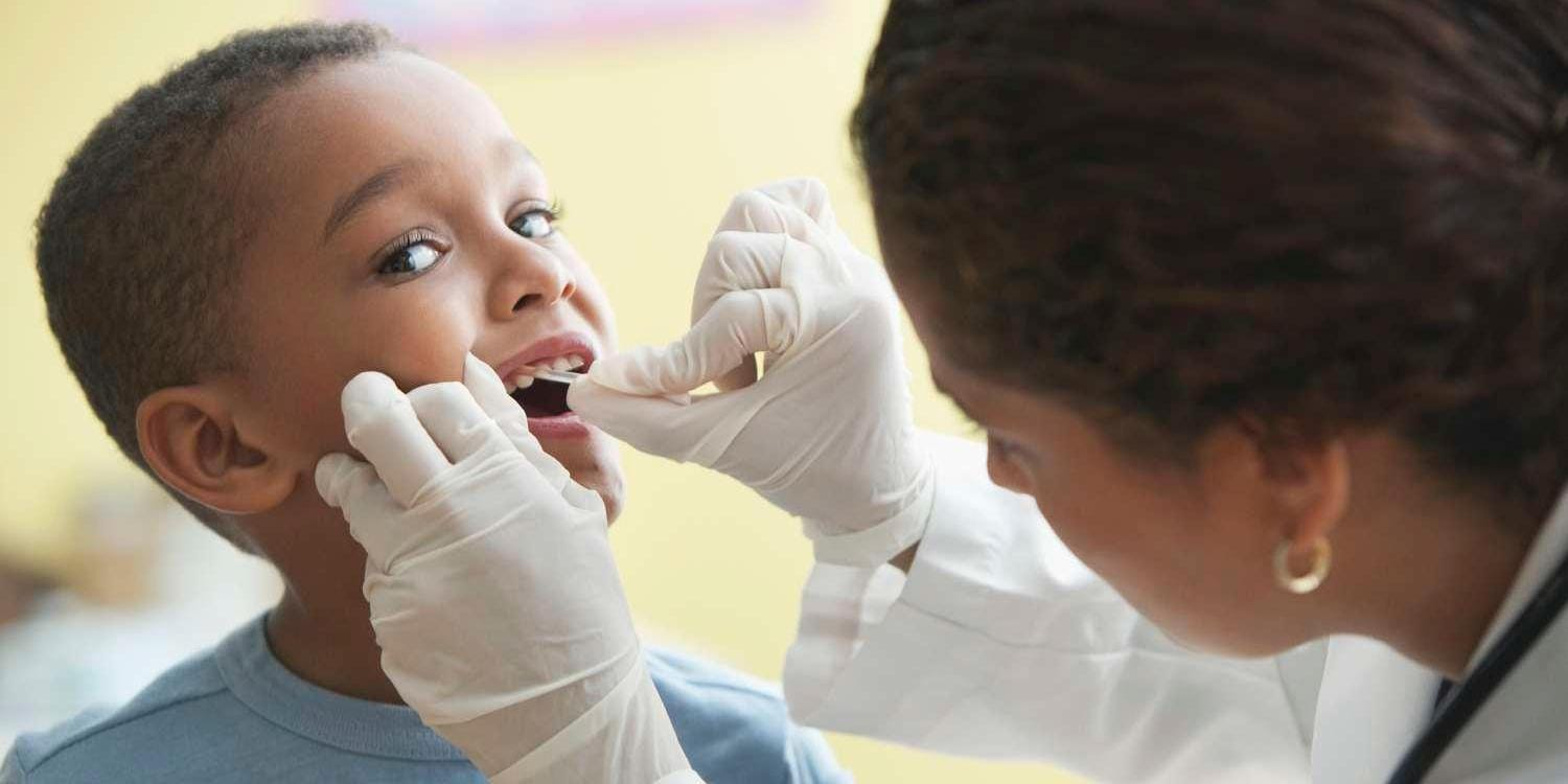Dentist checking a boy's teeth