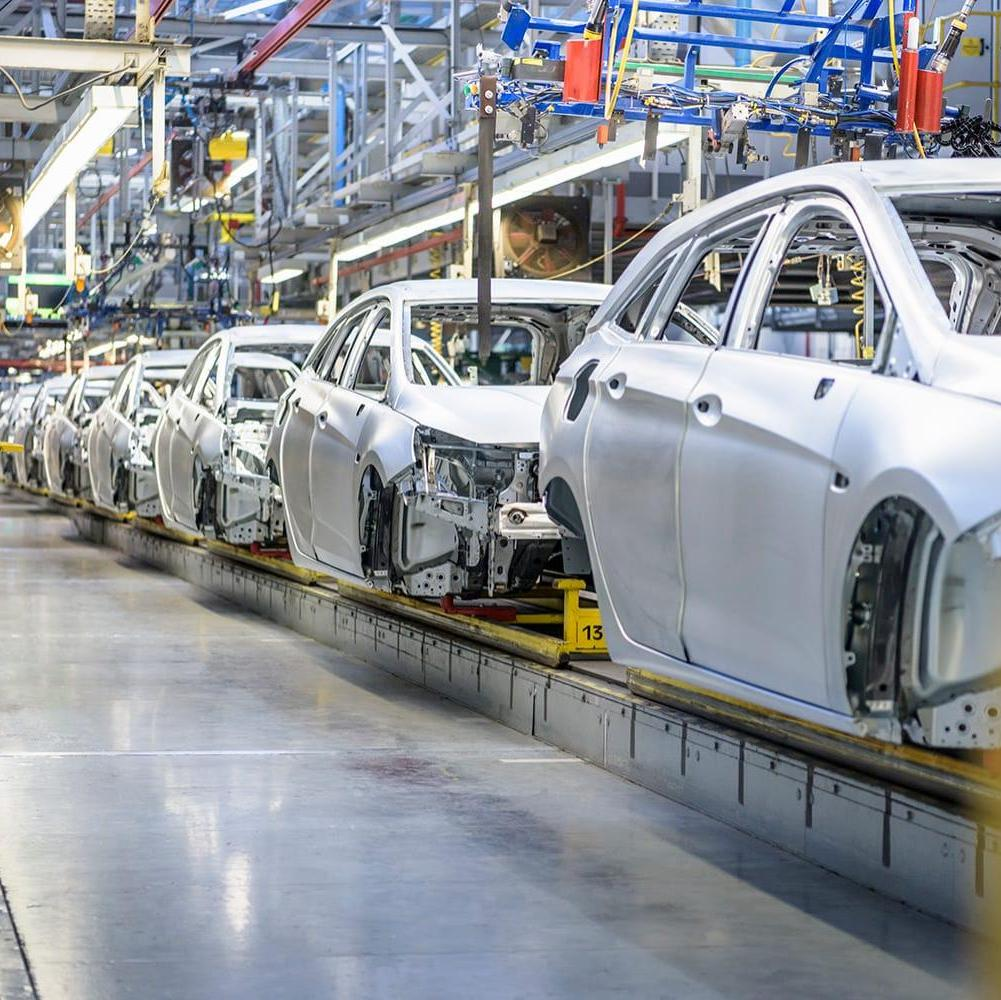 Row of cars in assembly line