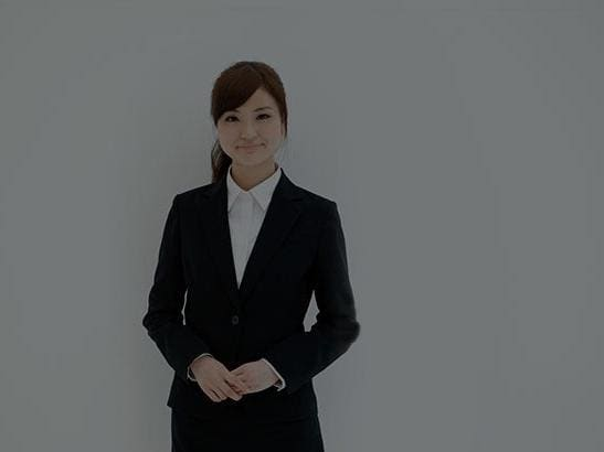 Young businesswoman wearing suit jacket smiling at camera