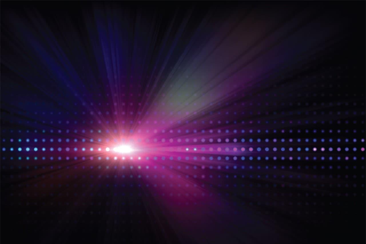 Spotlight with pink, purple and orange rays of light
