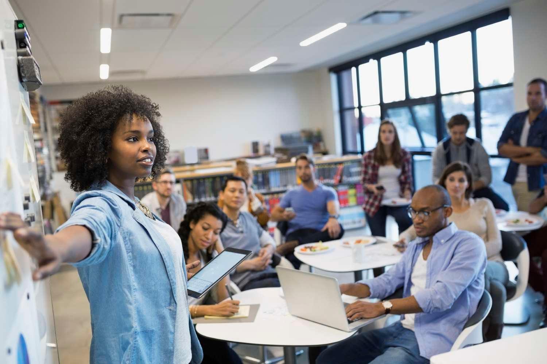 African American female instructing classroom