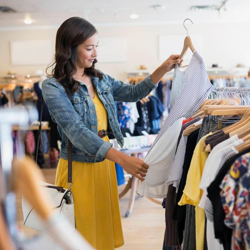 Woman Looking Through Clothes Rack