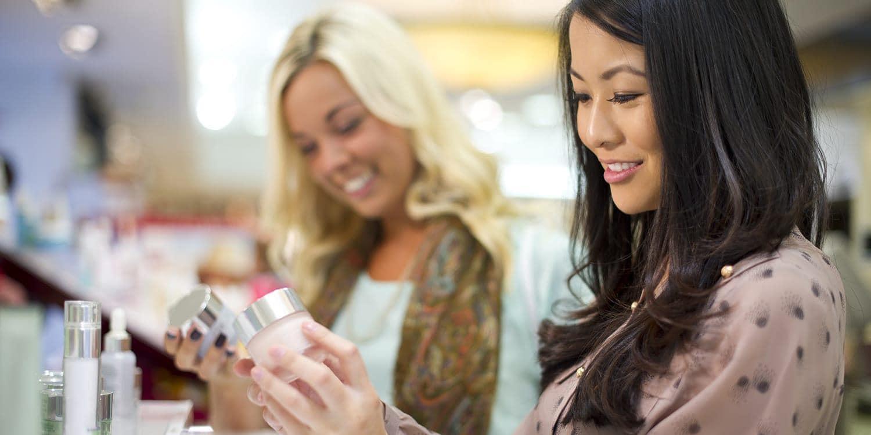 Two women shopping for cosmetics