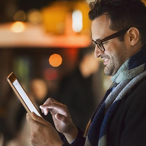 smiling-man-looking-at-tablet