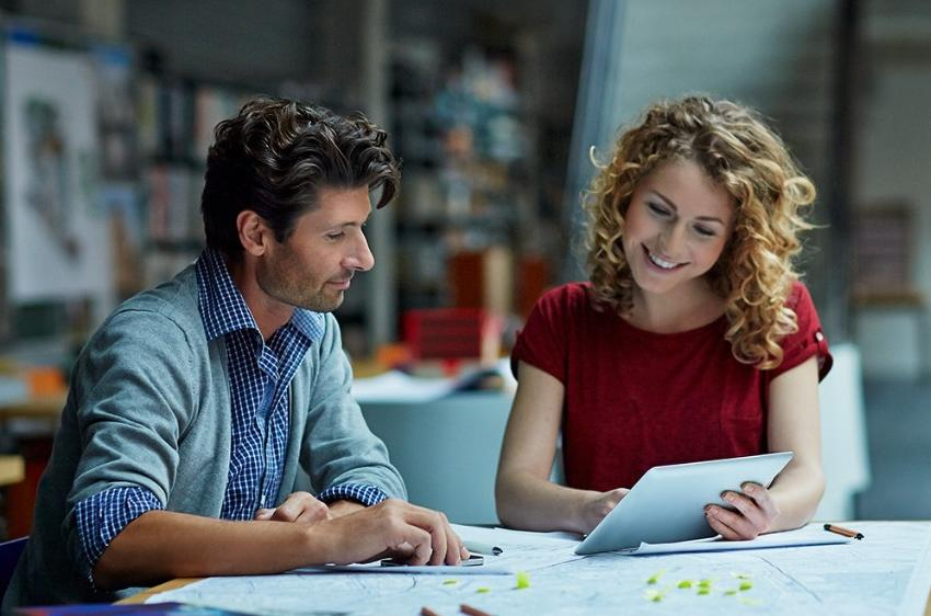 Man and woman looking at a tablet