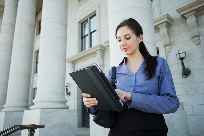 Caucasian businesswoman using digital tablet outdoors