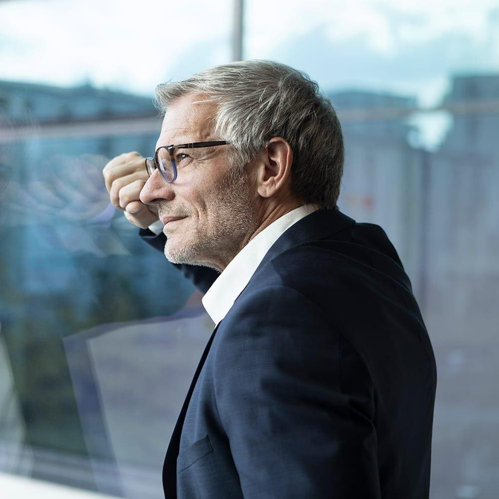 Chief marketing officer looking out of window