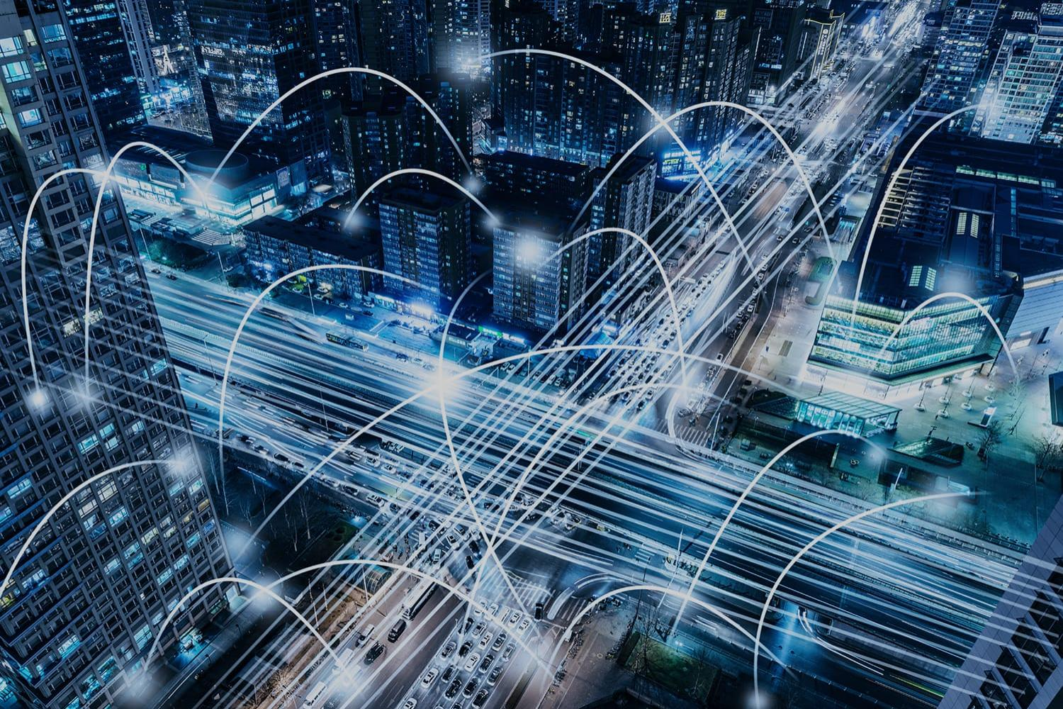 Cityscape at night with network connected data points