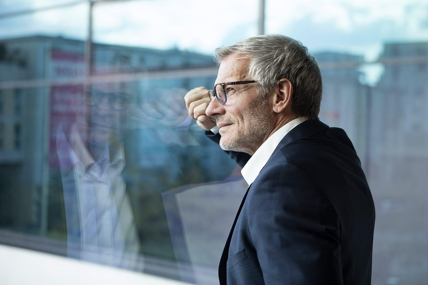 Confident businessman looking out of window