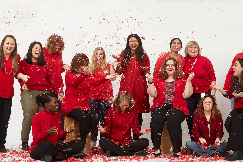 SAS women employees wearing red