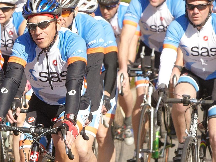 SAS-sponsored cycling team biking in group