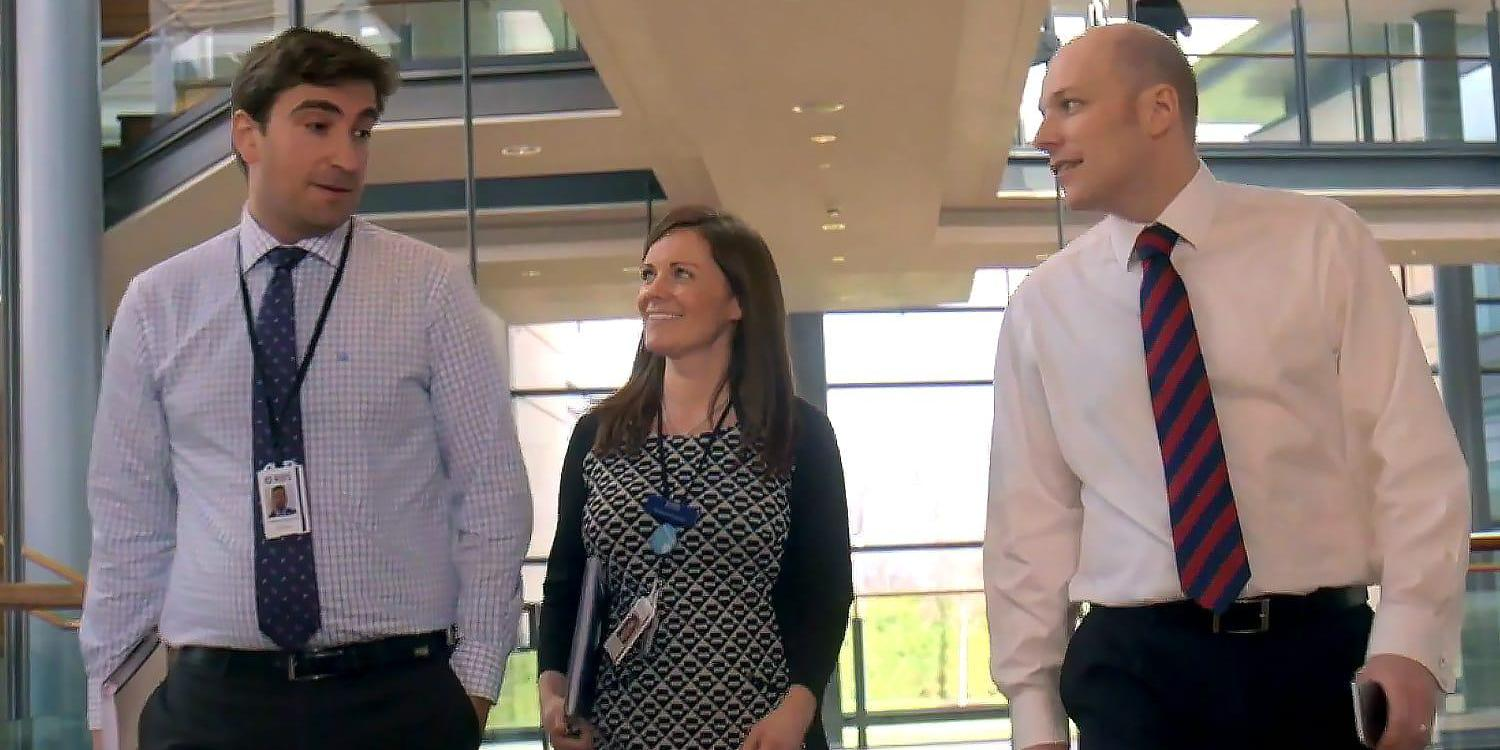 Three banking professionals walking together