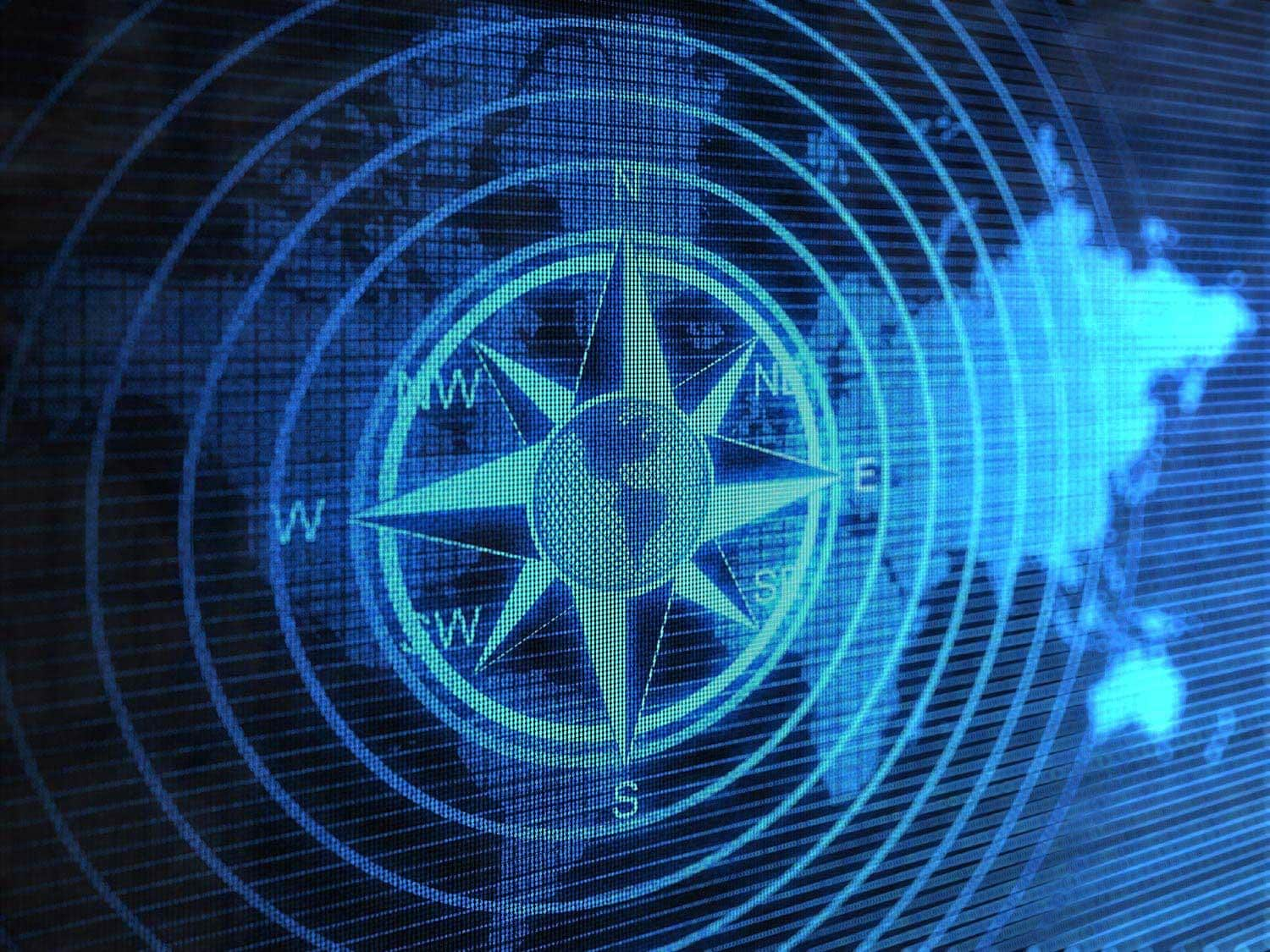 Compass over world map on computer screen