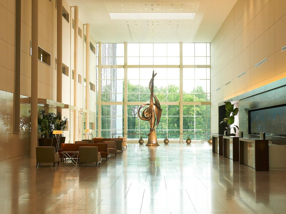 Lobby of Building C at Cary NC headquarters featuring original artwork, open spaces and natural lighting