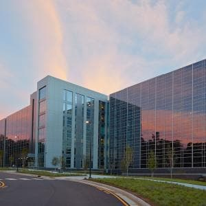 Front side view of SAS building Q at dusk