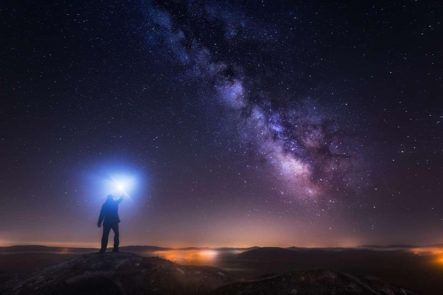 Man looking up at milky way