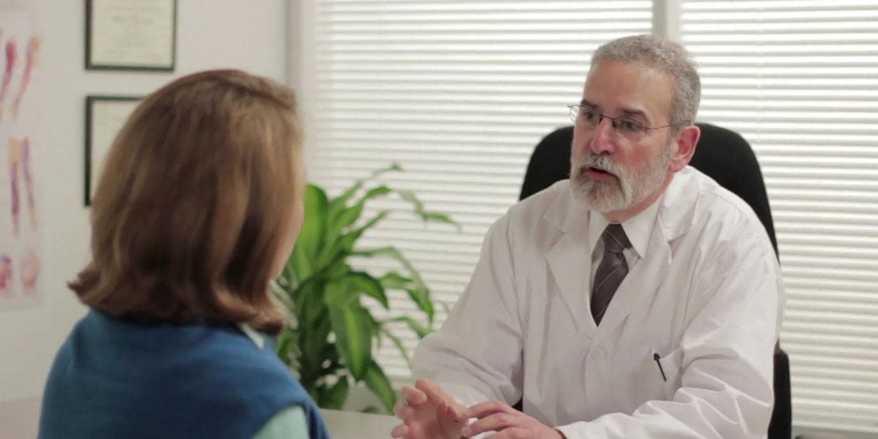Physician having conversation with patient