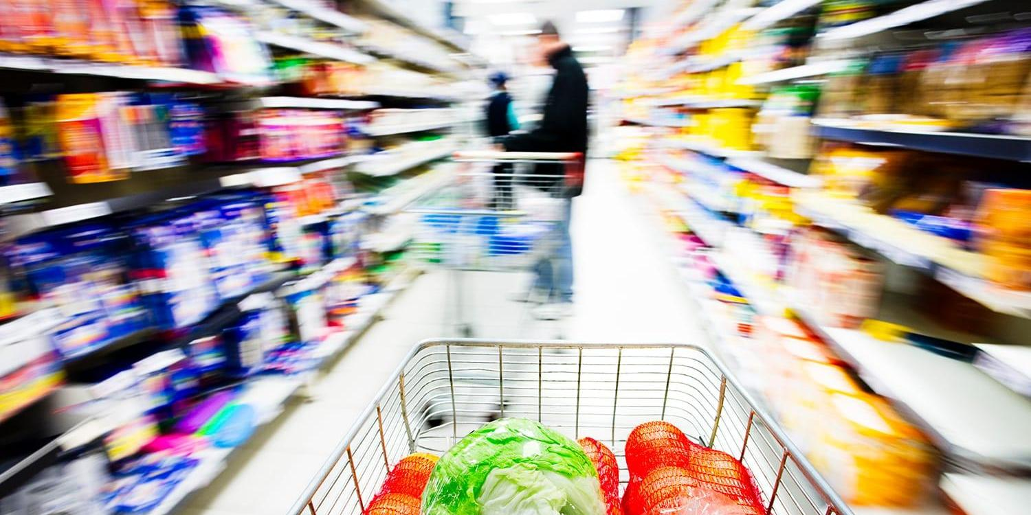 Grocery cart traveling down store aisle