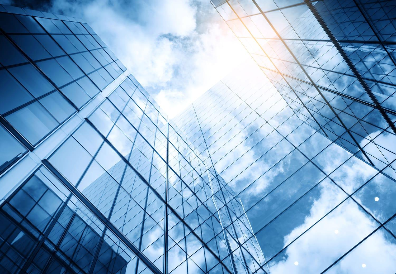 Clouds reflected on commercial building glass windows