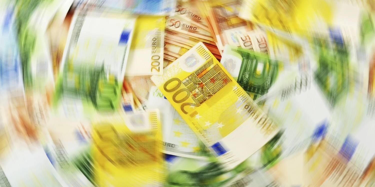 Composition of various banknotes in motion