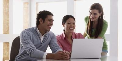 Team working at desk on laptop