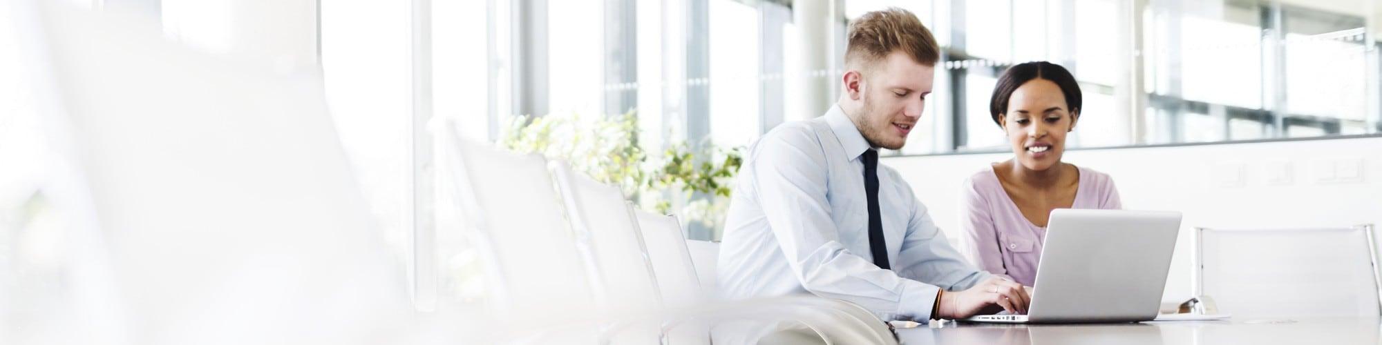 Man Woman using laptop