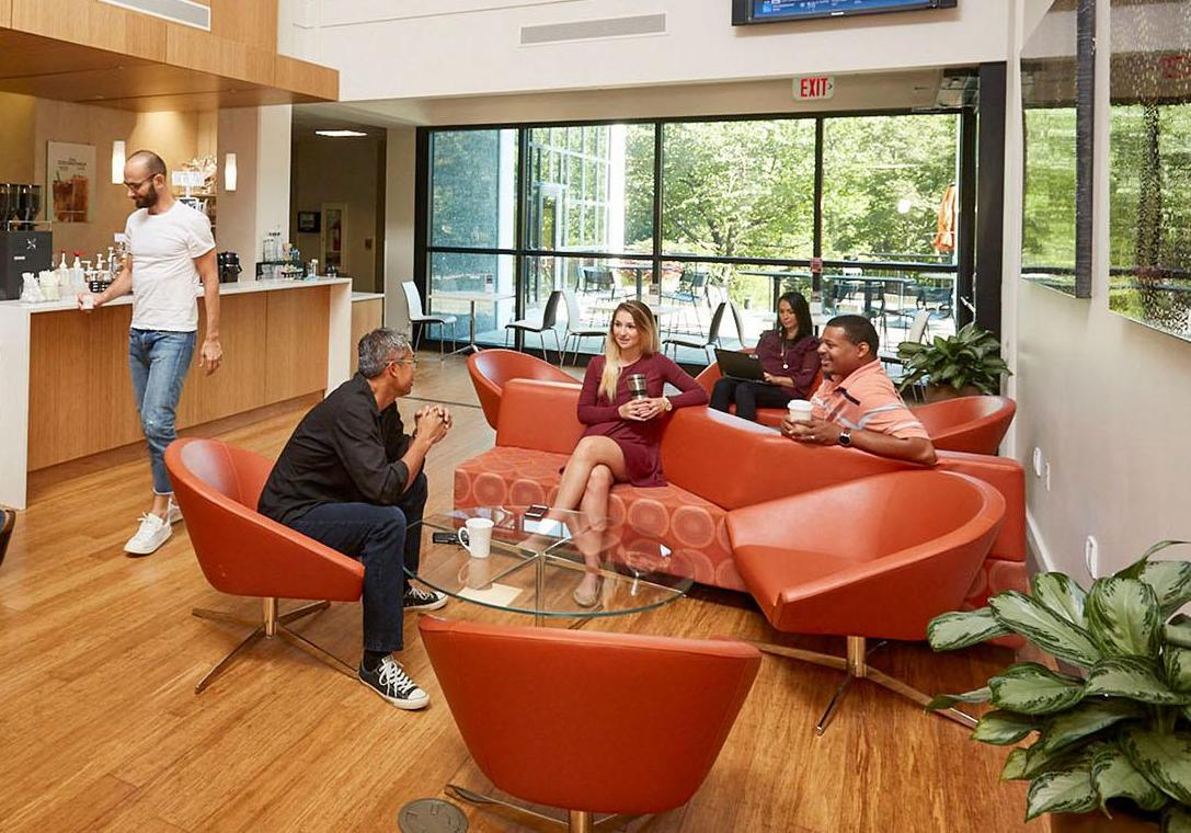 Business professionals in a open space lobby conversing