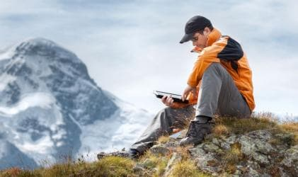 Mountain Hiker with tablet
