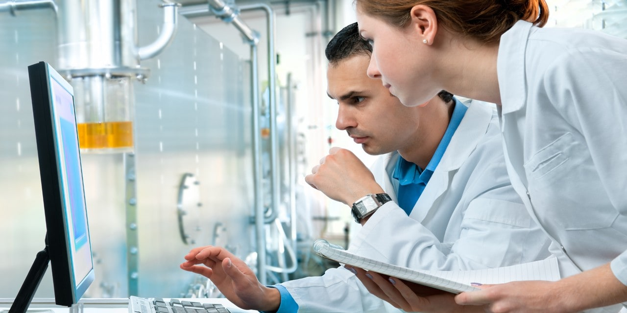 Two coworkers in laboratory manufacturing environment