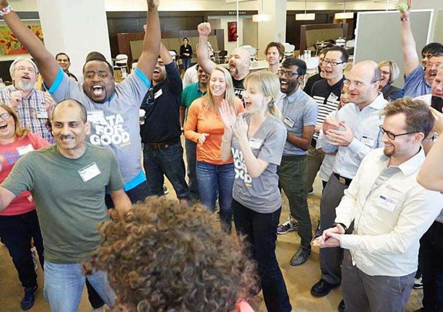 Group of employees excited about a Data for Good project