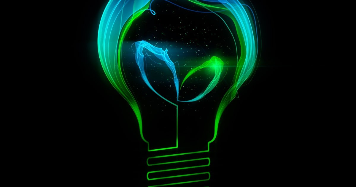 Light bulb with leafs made up of abstract energy
