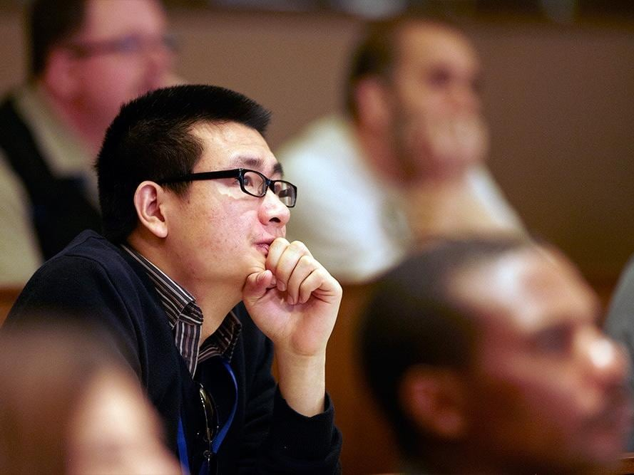 SAS employees listening to speaker during training session