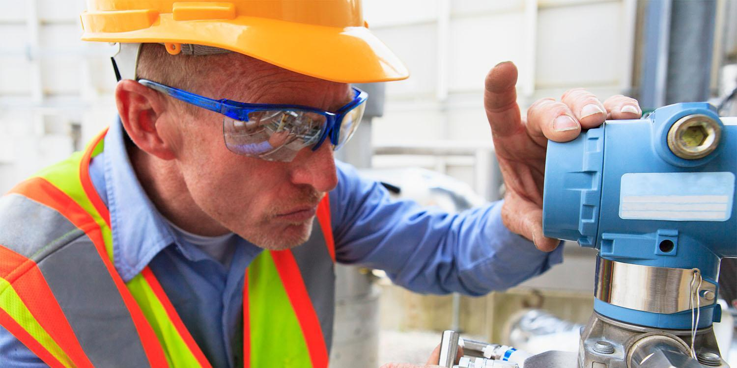 Engineer at electric power plant examining a transducer